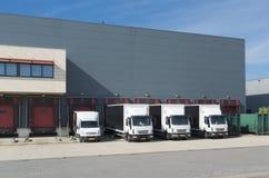 Trucks at warehouse building Royalty Free Stock Image