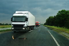 Trucks on wet asphalt stock image