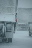 Trucks on winter highway during snowstorm Stock Photography