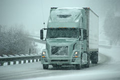 Trucks on winter highway during snowstorm Royalty Free Stock Images