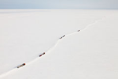 Trucks in winter tundra from above Royalty Free Stock Photography