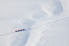 Trucks in winter tundra from above Royalty Free Stock Image
