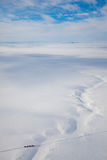 Trucks in winter tundra from above Stock Photography