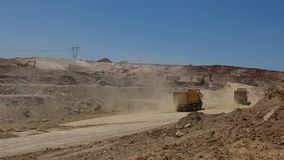 Trucks working in a career. Trucks and excavators working in a career, on mining operations stock footage