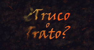 Truco o Trato et x28 ; Tour ou Treat& x29 ; Texte espagnol se dissolvant dans la poussière de la gauche Image stock