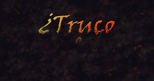Truco o Trato (Trick or Treat) Spanish text dissolving into dust from left stock video footage