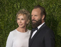 Trudie Styler and Sting at the 2015 Tonys. Trudie Styler and husband Sting, an actor/musician/singer/performer arrive on the red carpet for the 69th Annual Tony Stock Images