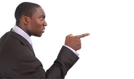 True Anger. This is an image of businessman angry businessman pointing his finger Stock Images