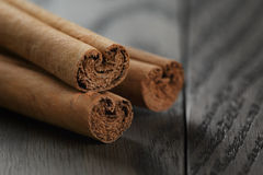 True cinnamon sticks on wooden table Royalty Free Stock Photo