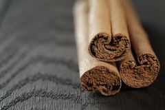 True cinnamon sticks on wooden table Royalty Free Stock Images