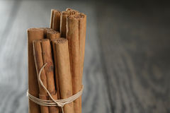 True cinnamon sticks on wooden table Stock Photos