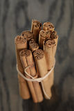 True cinnamon sticks on wooden table Stock Images