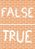 True and false. Words true and false painted across brick wall Royalty Free Stock Photography