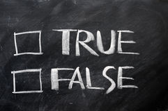 True and false check boxes. Written with chalk on a blackboard Royalty Free Stock Images