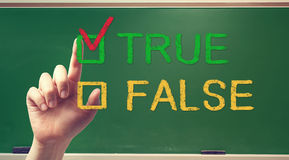 TRUE or FALSE checkbox with hand Stock Photo