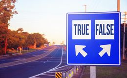 True or False choices, decision, option. Road sign on a highway with two different choices and arrows indicating the destination Royalty Free Stock Photos
