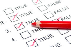 True False test with red pencil Royalty Free Stock Photo