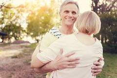 Handsome happy man hugging his wife Stock Image