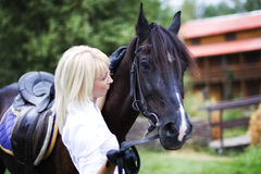 True friend. Girl with horse on nature Royalty Free Stock Photography