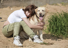 The true friend. The young woman embraces a dog Royalty Free Stock Photography