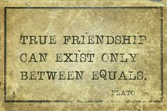 True friends Plato. True friendship can exist only between equals - ancient Greek philosopher Plato quote printed on grunge vintage cardboard Royalty Free Stock Photos
