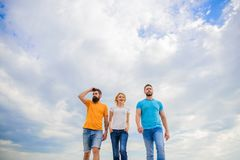True friendship grow with destiny obstacles. United threesome true friends. Keep moving trough long way. United group. Purposefully moves forward. Men and women stock image