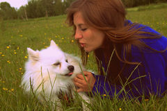 True friendship woman and dog in the grass Stock Photo