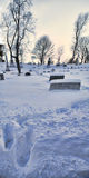 True Love. Footprints trace a path of love and respect through knee-deep snow to the grave of dearly departed Stock Image