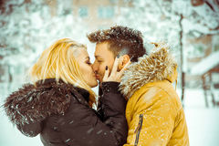 True love. Man and woman happily kissing on the street in the sn Stock Image