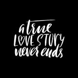A true love story never ends. Brush calligraphy, handwritten text isolated on white background for Valentine`s day card Stock Images