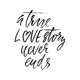 A true love story never ends. Brush calligraphy, handwritten text isolated on white background for Valentine`s day card Royalty Free Stock Images