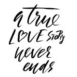 A true love story never ends. Brush calligraphy, handwritten text isolated on white Stock Photo