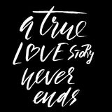 A true love story never ends. Brush calligraphy, handwritten text isolated  Stock Image