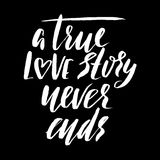 A true love story never ends. Brush calligraphy, handwritten text isolated on white  Royalty Free Stock Images