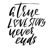 A true love story never ends. Brush calligraphy, handwritten text isolated on white  Stock Photos