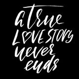 A true love story never ends. Brush calligraphy, handwritten text isolated on white Stock Image