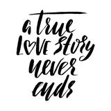 A true love story never ends. Brush calligraphy, handwritten text isolated on white  Royalty Free Stock Image