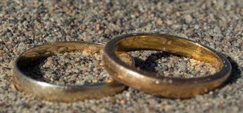 True Lovers Golden Pair of Rings in the Desert Stock Images