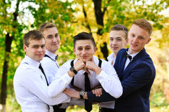 True men friendship. Group of handsome stylish men enjoying time together on wedding of their friend. Smiling happy cheerful men s. Group of olf men friends Stock Photos
