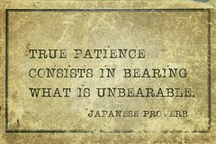 True patience JP. True patience consists in bearing what is unbearable - ancient Japanese proverb printed on grunge vintage cardboard royalty free stock images