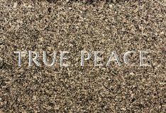 TRUE PEACE Carved in Stone Stock Photography