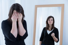 True reflection in the mirror. Woman and her true angry reflection in the mirror Stock Images