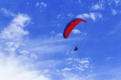 The true sense of freedom. People climbed the cable car and went down paragliding on the beach Royalty Free Stock Image
