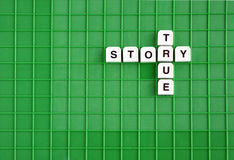 True story. Words composed of scrabble letters Stock Photo