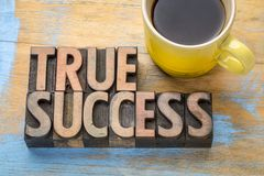 True success - word abstract in wood type. True success - word abstract in vintage letterpress printing blocks with a cup of coffee Stock Image