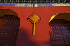 A truelove knot on the red wall. A truelove knot on the gate tower of Temple of Heaven Stock Photography