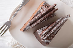 Truffle cake decorated with chocolate chips on a plate close-up Royalty Free Stock Photo