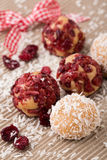 Truffle candy brigadeiros with coconut and cranberry Stock Photo