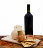 Truffle cheese. And wine on a cutting board royalty free stock image