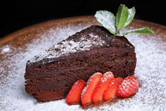 Truffle chocolate cake with strawberries Stock Images